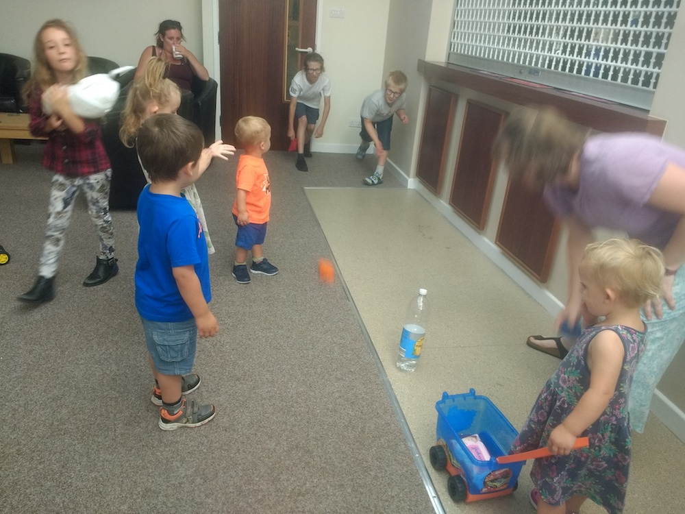 Children playing at a pizza party - Cumbria Deaf Association
